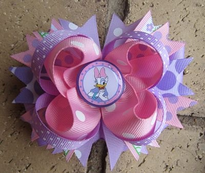 Custom Boutique Hair Bow made to match Daisy Duck. $9.99, via Etsy.