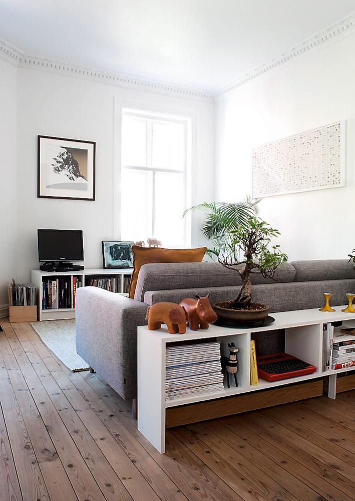 casual #living_room with storage behind the sofa