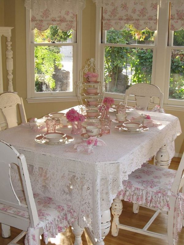 Romantic pink and white shabby chic dining area beside windows. Clear, brignt an...