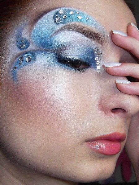 Artistic swirled eye shadow in shades of blue accented with crystals, titled &#3...